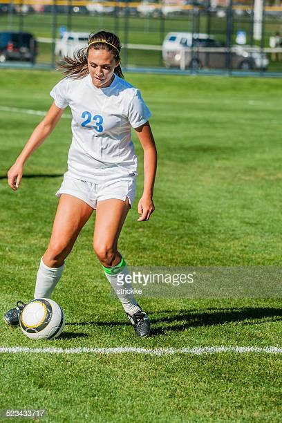 Attractive Female Soccer Player in White Executes Cutback Touch