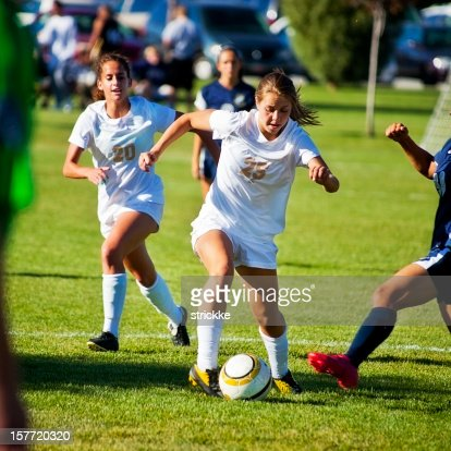 Attractive Female Soccer Players Compete for Control of Ball