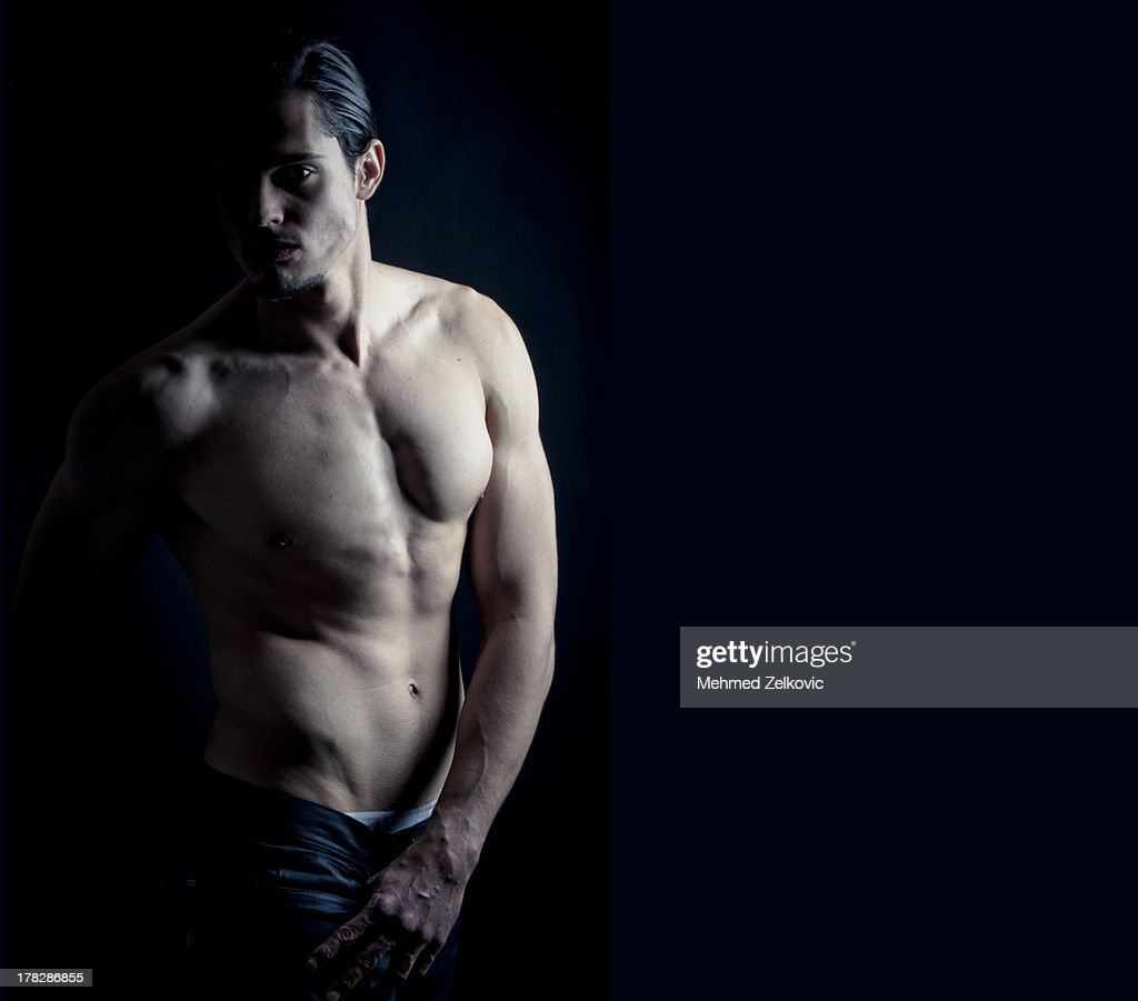Attractive fit young man posing : Stock Photo