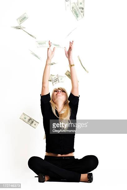 Attractive girl catching rain of dollars