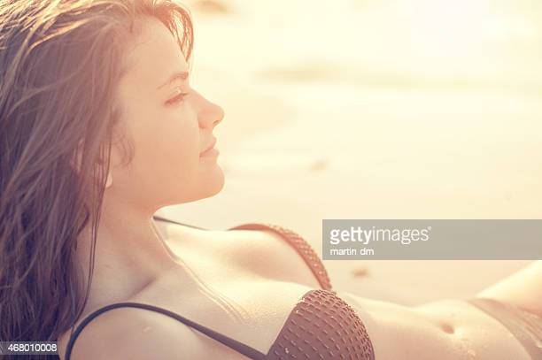 Attractive girl sunbathing at the beach