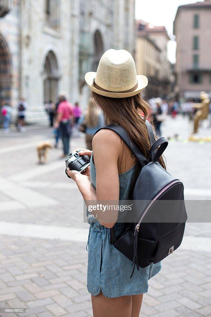 Attractive girl taking photos : Stock Photo