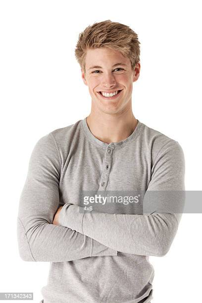 Attractive happy man standing with his arms crossed