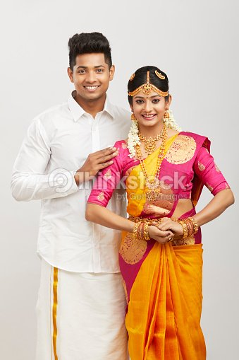 c31fccbc9 Attractive happy south Indian couple in traditional dress : Stock Photo