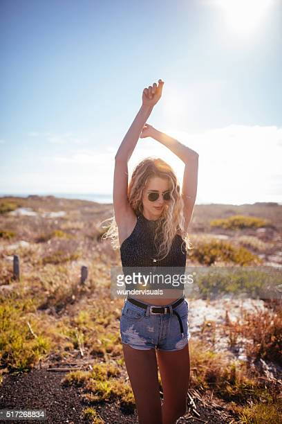 Attractive hipster girl Walking in Beach Dunes