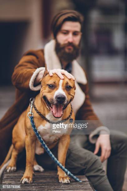 Attractive hipster man with his cute dog