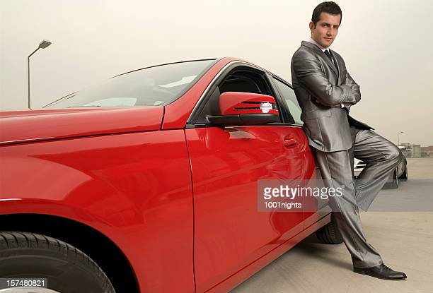 Attractive male and his red sports car