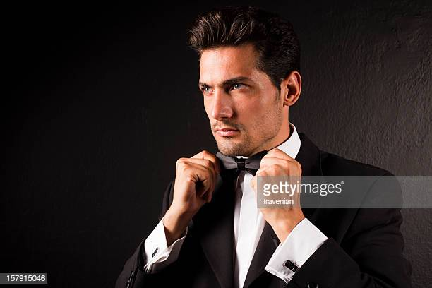 Attractive Male Model Tying Bow Tie