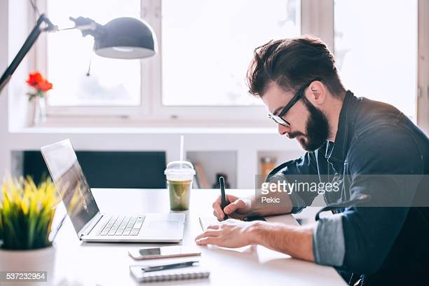 Attractive man working at modern office space