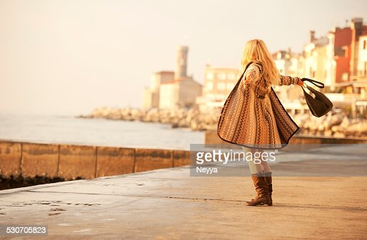 Attractive Mature Woman In Woolen Clothings Walking in Piran, Slovenia