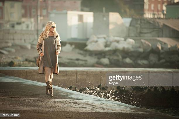 Attractive Mature Woman In Woolen Clothings Walking