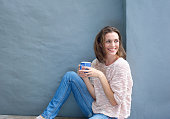 Portrait of an attractive mid adult woman relaxing with a cup of coffee
