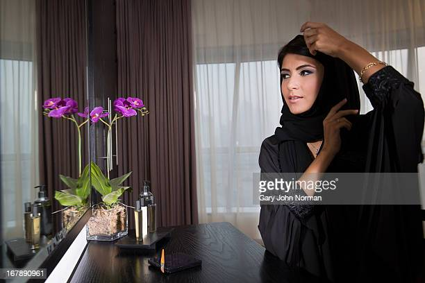 Attractive middle eastern woman looking in mirror