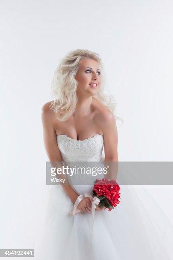 Attractive model posing in wedding attire : Stock Photo