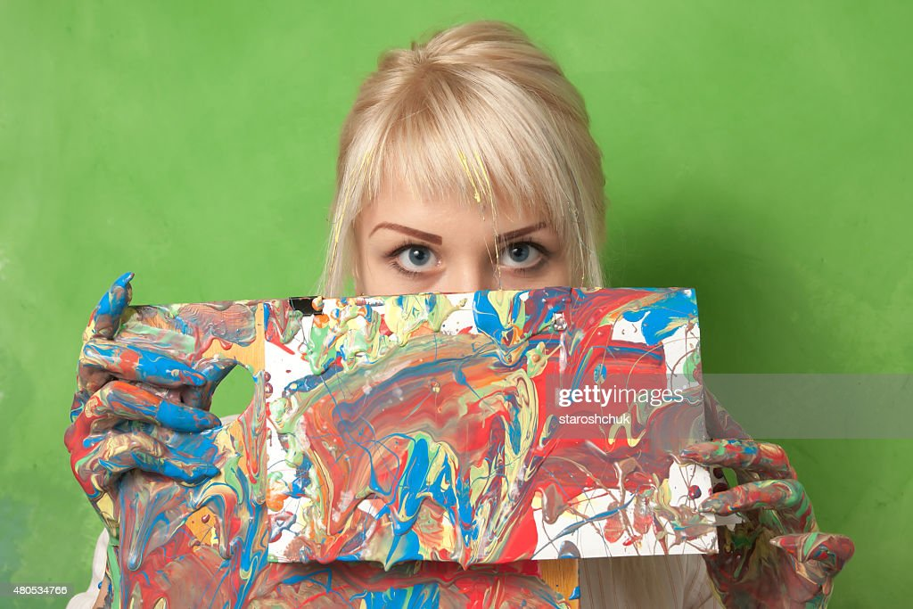 Attractive Painter and Her Painting : Stockfoto