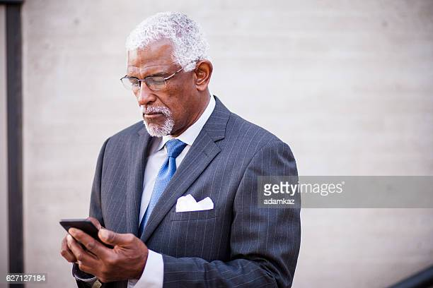 Attractive Senior African American Business Man Using Phone