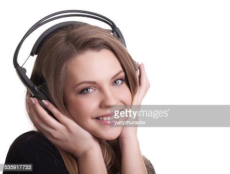 attractive smiling woman with headphones on white background : Stock Photo