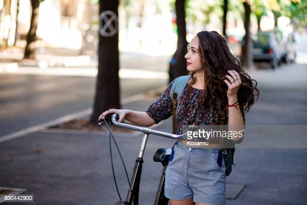 Attractive Student Girl Walking On Streets By Her Big Retro Bike
