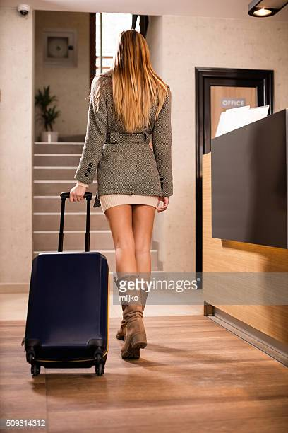 Attractive woman arrives in hotel