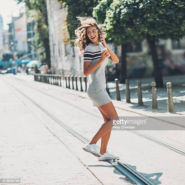 Attractive woman crossing the street in a hurry