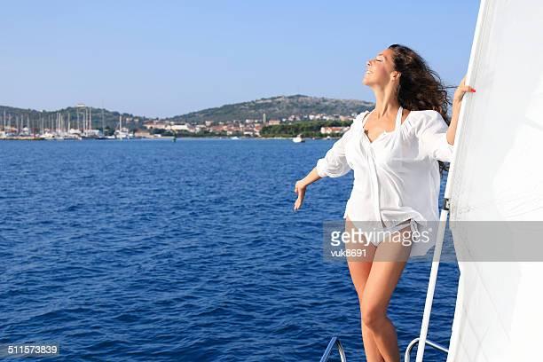 Attractive woman enjoys sailing