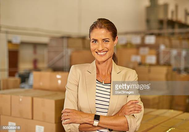 Attractive woman in a distribution warehouse
