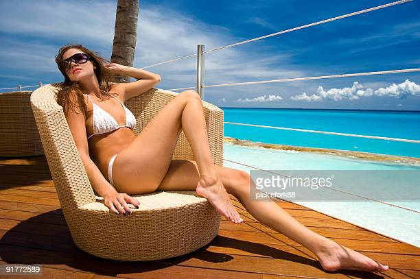 Attractive woman in bikini at beach resort