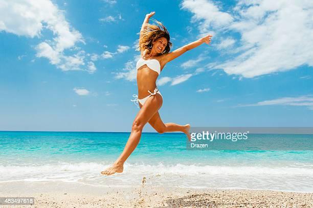 Attractive woman in bikini in summer enjoys summer in Maldives