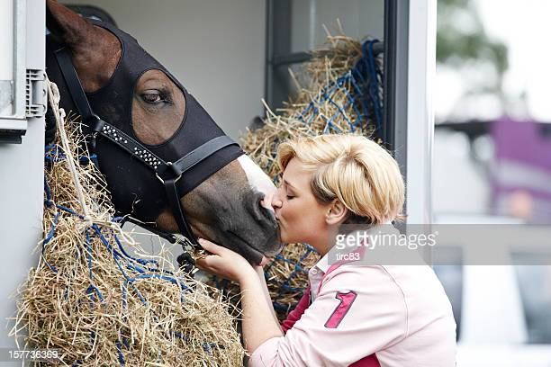 Attractive woman kissing a horse