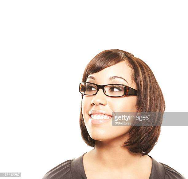 Attractive woman looking at copy space and smiling