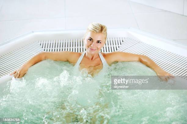 Attractive woman relaxing in the Jacuzzi.