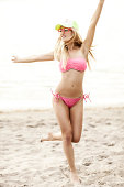 Attractive Woman Running On Beach