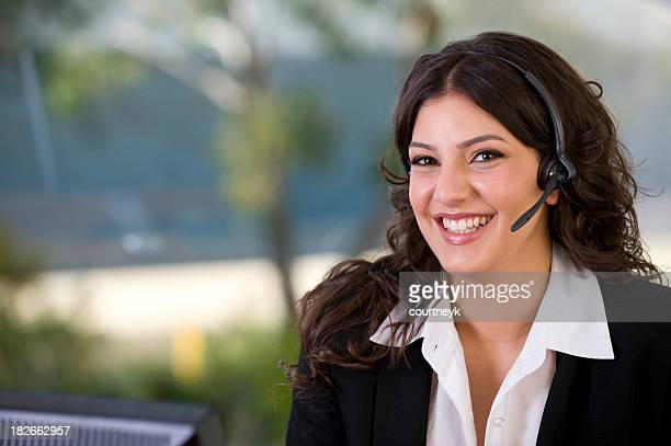 Attractive woman smiling with telephone headset