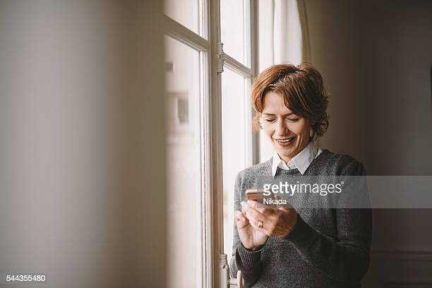 Attractive woman texting on her mobile phone