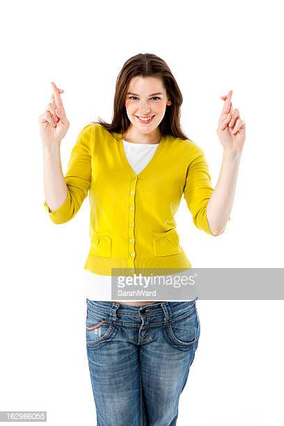 Attractive woman with fingers crossed