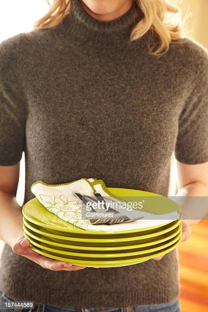 Attractive Woman With Pile of Green Plates