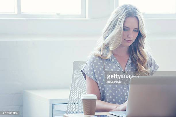 Attractive woman working on a laptop computer.