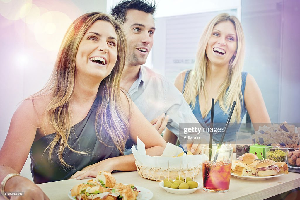 Attractive women and man enjoying aperitivo in a bar : Stock Photo