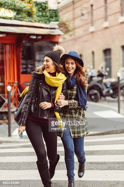 Attractive women crossing the street in Paris