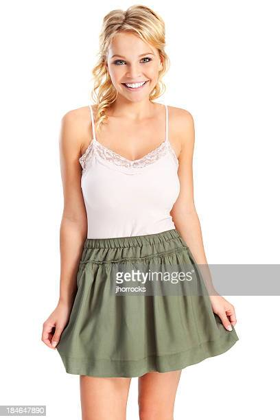Attractive Young Blonde Woman in Green Skirt