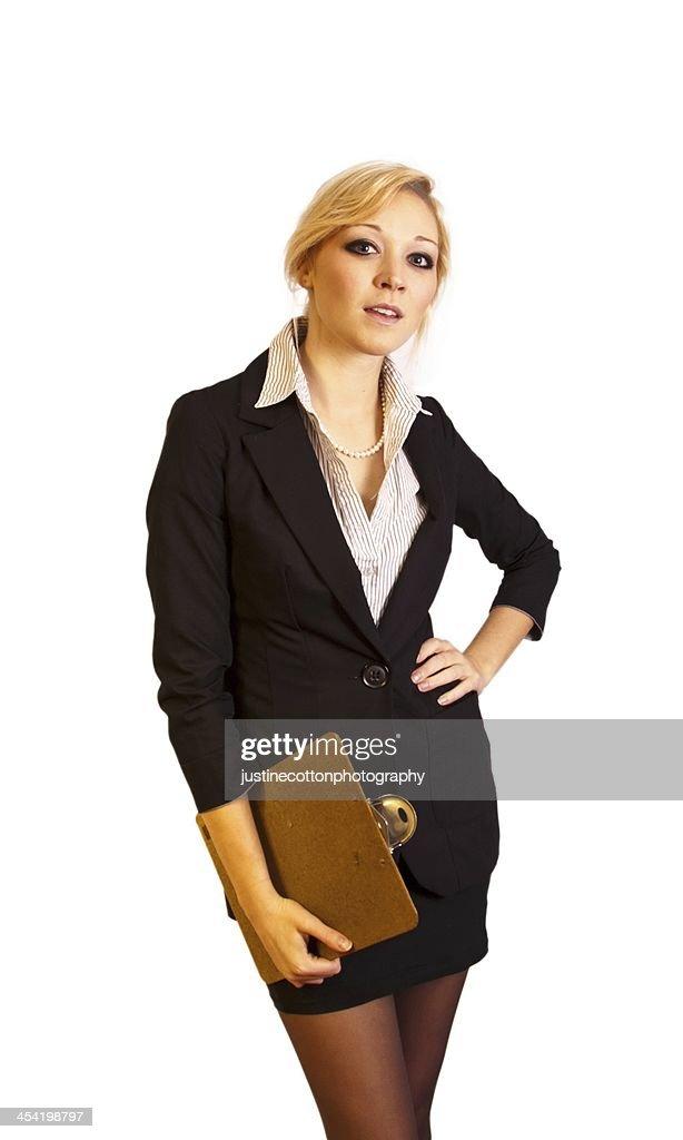 Atraente jovem Mulher de negócios com um caderno de Escrita : Foto de stock