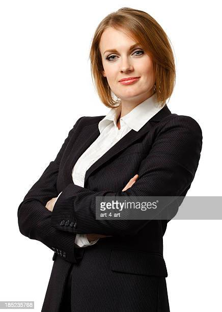 Attractive young businesswoman with her arms crossed