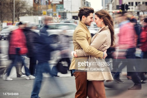 Attractive Young Couple Embracing on Potsdamer Platz : Stock Photo