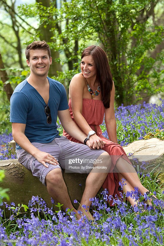 Attractive young couple in Bluebell Woods
