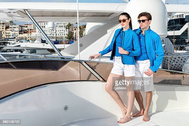 Attractive young couple on luxury yacht