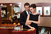 Attractive Young Couple Shopping for Rings in Jewelry Store, Copyspace