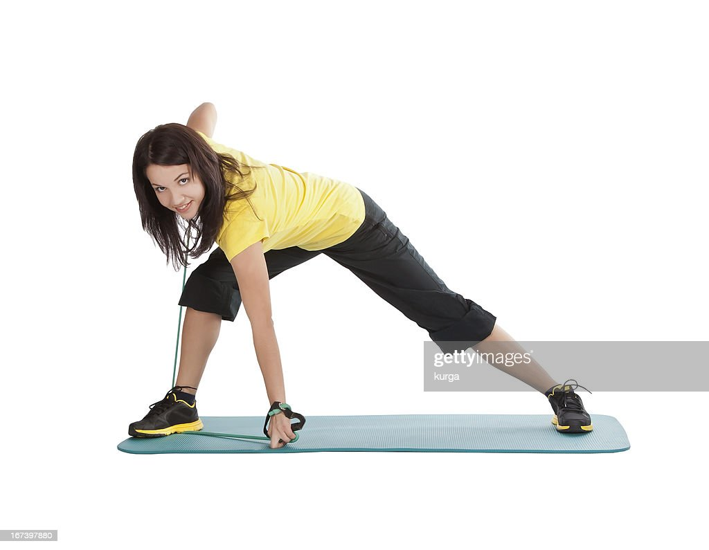 Attractive young female with fitness expander in stretching : Stock Photo