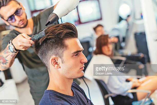 Attractive young man at hair stylist