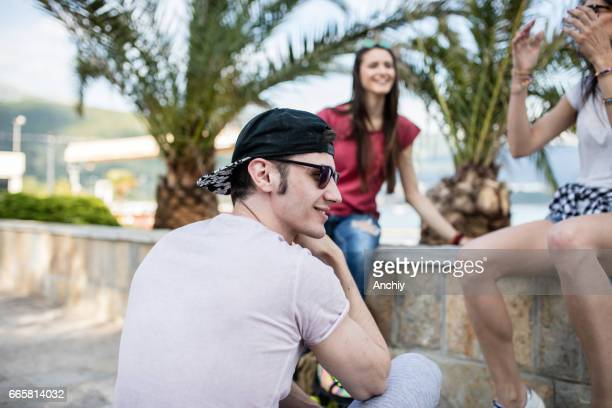 Attractive young man enjoying girls company, depth of field