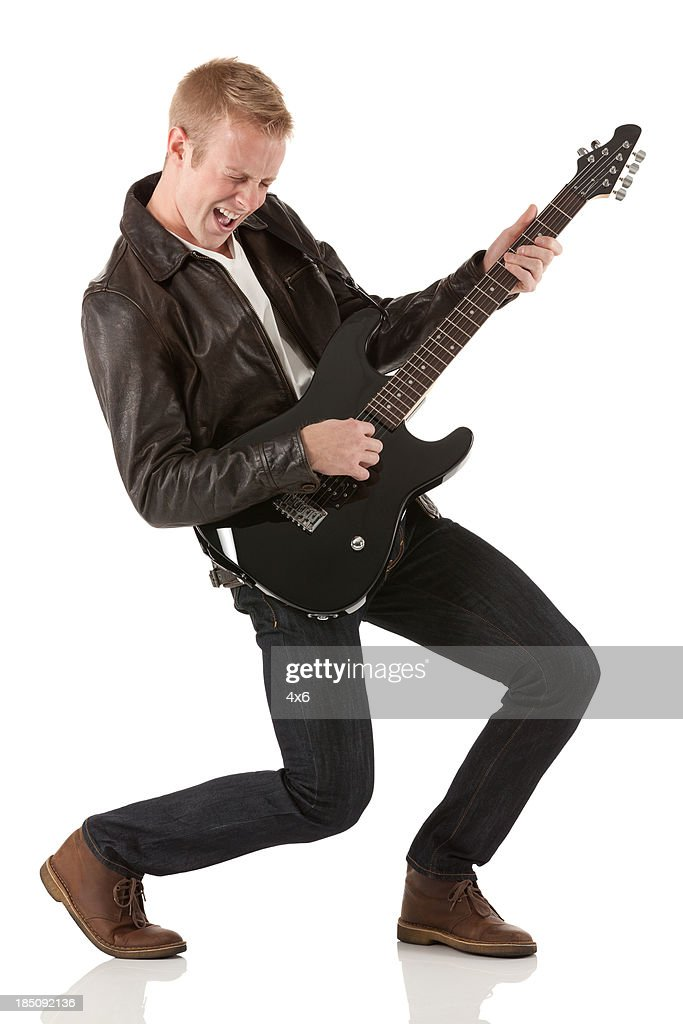Attractive young man playing a guitar
